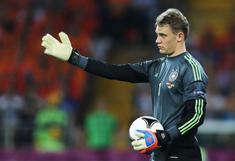 KHARKOV, UKRAINE - JUNE 13:  Manuel Neuer of Germany in action during the UEFA EURO 2012 group B match between Netherlands and Germany at Metalist Stadium on June 13, 2012 in Kharkov, Ukraine.  (Photo by Ian Walton/Getty Images)