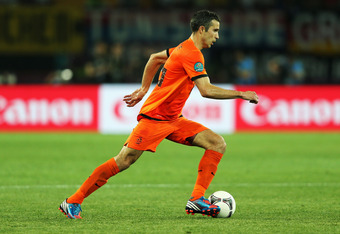KHARKOV, UKRAINE - JUNE 13:  Robin van Persie of Netherlands in action during the UEFA EURO 2012 group B match between Netherlands and Germany at Metalist Stadium on June 13, 2012 in Kharkov, Ukraine.  (Photo by Ian Walton/Getty Images)