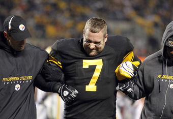 PITTSBURGH, PA - DECEMBER 8:   Ben Roethlisberger #7 of the Pittsburgh Steelers is helped off the field after being sacked by the Cleveland Browns during the game on December 8, 2011 at Heinz Field in Pittsburgh, Pennsylvania.  (Photo by Justin K. Aller/G