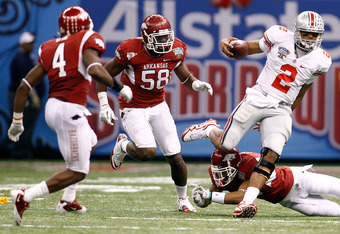 NEW ORLEANS, LA - JANUARY 04:  Quarterback Terrelle Pryor #2 of the Ohio State Buckeyes looks to run against the Arkansas Razorbacks during the Allstate Sugar Bowl at the Louisiana Superdome on January 4, 2011 in New Orleans, Louisiana.  (Photo by Chris G