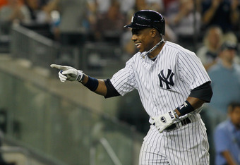 NEW YORK, NY - JUNE 09: Curtis Granderson #14 of the New York Yankees celebrates after hitting a solo home run in the eighth inning during the game against the New York Mets at Yankee Stadium on June 9, 2012 in the Bronx borough of New York City.  Yankees