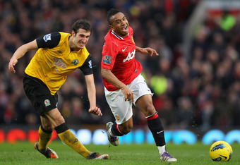MANCHESTER, ENGLAND - DECEMBER 31:  Anderson of Manchester United is tackled by Radosav Petrovic of Blackburn Rovers during the Barclays Premier League match between Manchester United and Blackburn Rovers at Old Trafford on December 31, 2011 in Manchester