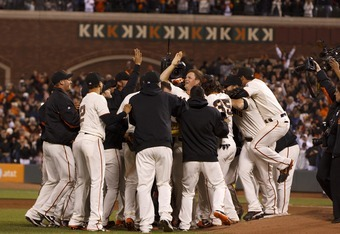 Matt Cain's Giants teammates swarm around him in celebration of his perfect game.