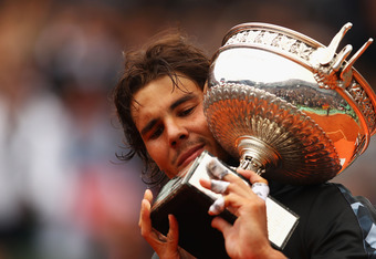 PARIS, FRANCE - JUNE 11:  Rafael Nadal of Spain poses with the Coupe des Mousquetaires trophy in the men's singles final against Novak Djokovic of Serbia during day 16 of the French Open at Roland Garros on June 11, 2012 in Paris, France.  (Photo by Clive
