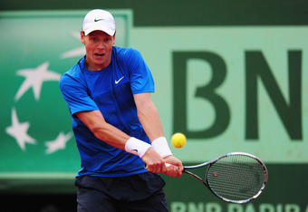 PARIS, FRANCE - JUNE 03:  Tomas Berdych of Czech Republic plays a backhand in his men's singles fourth round match against Juan Martin Del Potro of Argentina during day 8 of the French Open at Roland Garros on June 3, 2012 in Paris, France.  (Photo by Mik