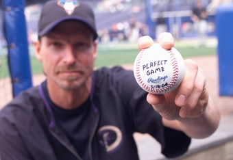 ATLANTA - MAY 19:  Randy Johnson of the Arizona Diamondbacks poses with a ball on May 19, 2004 at Turner Field in Atlanta, Georgia.  The ball is commemorating his perfect game against the Atlanta Braves on May 18.  (Photo by Scott Cunningham/Getty Images)