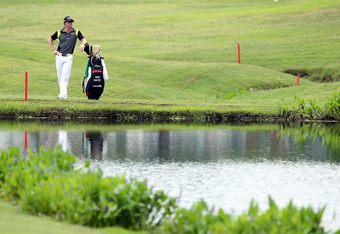 MEMPHIS, TN - JUNE 10:  Rory McIlroy of Northern Ireland waits to hit his third shot on the par 4 18th hole after hitting his tee shot in the water during the final round of the FedEx St. Jude Classic at TPC Southwind on June 10, 2012 in Memphis, Tennesse