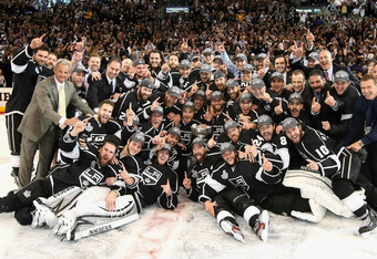 LOS ANGELES, CA - JUNE 11:  The Los Angeles Kings pose together with the Stanley Cup in a group photo after defeating the New Jersey Devils in Game Six of the 2012 Stanley Cup Finals at Staples Center on June 11, 2012 in Los Angeles, California. The Kings