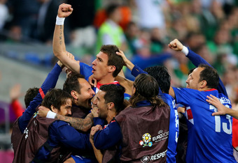 POZNAN, POLAND - JUNE 10:  Mario Mandzukic of Croatia celebrates scoring their third goal with team mates during the UEFA EURO 2012 group C between Ireland and Croatia at The Municipal Stadium on June 10, 2012 in Poznan, Poland.  (Photo by Christof Koepse