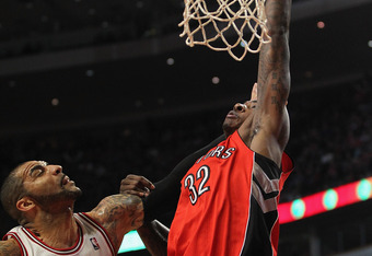 Ed Davis of the Toronto Raptors dunks the ball.