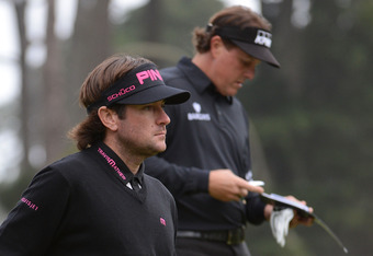 SAN FRANCISCO, CA - JUNE 14:  Bubba Watson (L) and Phil Mickelson of the United States wait on the tenth tee during the first round of the 112th U.S. Open at The Olympic Club on June 14, 2012 in San Francisco, California.  (Photo by Harry How/Getty Images