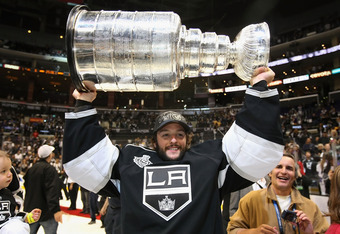 LOS ANGELES, CA - JUNE 11:  Goaltender Jonathan Bernier #32 of the Los Angeles Kings hoists the Stanley Cup in celebration after defeating the New Jersey Devils in Game Six of the 2012 Stanley Cup Finals at Staples Center on June 11, 2012 in Los Angeles,