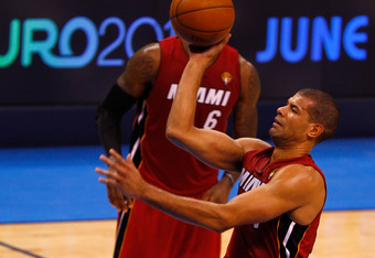 OKLAHOMA CITY, OK - JUNE 12:  Shane Battier #31 of the Miami Heat goes up for a shot over Kendrick Perkins #5 of the Oklahoma City Thunder in Game One of the 2012 NBA Finals at Chesapeake Energy Arena on June 12, 2012 in Oklahoma City, Oklahoma. NOTE TO U