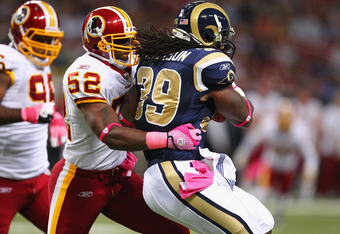 ST. LOUIS, MO - OCTOBER 02: Rocky McIntosh #52 of the Washington Redskins defends against the St. Louis Rams at the Edward Jones Dome on October 2, 2011 in St. Louis, Missouri.  The Washington Redskins beat the St. Louis Rams 17-10.  (Photo by Dilip Vishw