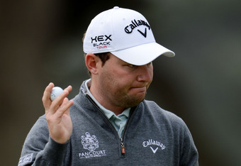 SAN FRANCISCO, CA - JUNE 14:  Branden Grace of South Africa waves to the gallery during the first round of the 112th U.S. Open at The Olympic Club on June 14, 2012 in San Francisco, California.  (Photo by Stuart Franklin/Getty Images)