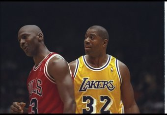 2 Feb 1996:  Guard Earvin (Magic) Johnson of the Los Angeles Lakers confers with Chicago Bulls guard Michael Jordan during a game at the Great Western Forum in Inglewood, California.  The Bulls won the game, 99-84. Mandatory Credit: ALLSPORT USA  /Allspor