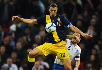 LONDON, ENGLAND - NOVEMBER 15:  Zlatan Ibrahimovic of Sweden beats John Terry of England to the ball during the international friendly match between England and Sweden at Wembley Stadium on November 15, 2011 in London, England.  (Photo by Mike Hewitt/Gett