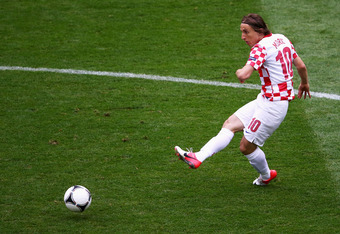 POZNAN, POLAND - JUNE 14:  Luka Modric of Croatia passes the ball during the UEFA EURO 2012 group C match between Italy and Croatia at The Municipal Stadium on June 14, 2012 in Poznan, Poland.  (Photo by Christof Koepsel/Getty Images)
