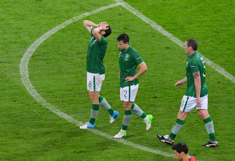 GDANSK, POLAND - JUNE 14:  Keith Andrews, Sean St Ledger and  Richard Dunne of Republic of Ireland react during the UEFA EURO 2012 group C match between Spain and Ireland at The Municipal Stadium on June 14, 2012 in Gdansk, Poland.  (Photo by Shaun Botter