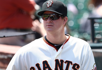 Is Matt Cain shading his eyes or hiding from people?