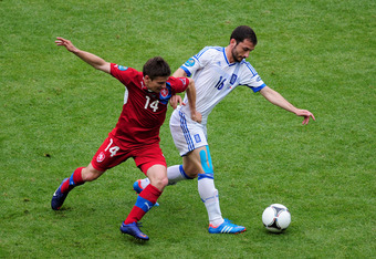 WROCLAW, POLAND - JUNE 12:  Vaclav Pilar of Czech Republic and Giorgos Fotakis of Greece fight for the ball during the UEFA EURO 2012 group A match between Greece and Czech Republic at The Municipal Stadium on June 12, 2012 in Wroclaw, Poland  (Photo by J