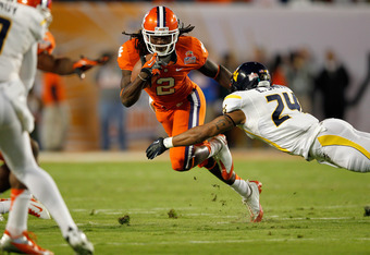 MIAMI GARDENS, FL - JANUARY 04:  Sammy Watkins #2 of the Clemson Tigers runs for yards after the catch against Eain Smith #24 of the West Virginia Mountaineers during the Discover Orange Bowl at Sun Life Stadium on January 4, 2012 in Miami Gardens, Florid