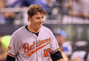 KANSAS CITY, MO - AUGUST 02:  Mark Reynolds #12 of the Baltimore Orioles smiles after scoring on an error during the 5th inning of the game against the Kansas City Royals on August 2, 2011 at Kauffman Stadium in Kansas City, Missouri.  (Photo by Jamie Squ