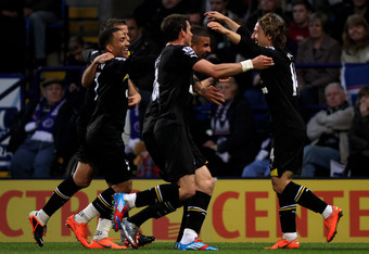 BOLTON, ENGLAND - MAY 02:   Luka Modric of Tottenham Hotspur celebrates with his team mates after scoring the opening goal during the Barclays Premier League match between Bolton Wanderers and Tottenham Hotspur at the Reebok Stadium on May 2, 2012 in Bolt