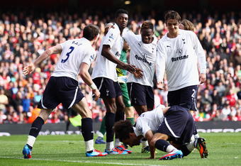 LONDON, ENGLAND - FEBRUARY 26:  Emmanuel Adebayor of Tottenham Hotspur is mobbed by team mates after scoring his penalty during the Barclays Premier League match between Arsenal and Tottenham Hotspur at Emirates Stadium on February 26, 2012 in London, Eng