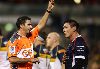 CANBERRA, AUSTRALIA - APRIL 14: Referee Craig Joubert gives Gareth Delve of the Rebels a yellow card during the round eight Super Rugby match between the Brumbies and the Rebels at Canberra Stadium on April 14, 2012 in Canberra, Australia.  (Photo by Mark