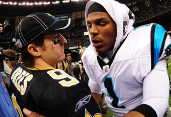 NEW ORLEANS, LA - JANUARY 1: Drew Brees #9 of the New Orleans Saints is greeted by Cam Newton #1 of the Carolina Panthers after the game at the Mercedes-Benz Superdome on January 1, 2012 in New Orleans, Louisiana  (Photo by Scott Cunningham/Getty Images)