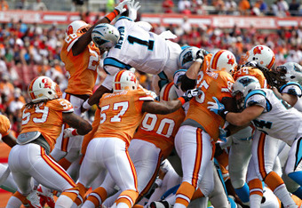 Newton rushes for one of three touchdowns vs. Tampa Bay (Source: Daniel Wallace, TIMES)