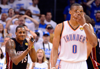 OKLAHOMA CITY, OK - JUNE 14:  Mario Chalmers #15 of the Miami Heat reacts behind Russell Westbrook #0 of the Oklahoma City Thunder in the fourth quarter in Game Two of the 2012 NBA Finals at Chesapeake Energy Arena on June 14, 2012 in Oklahoma City, Oklah