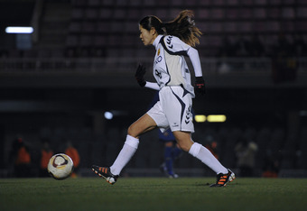 BARCELONA, SPAIN - FEBRUARY 02:  Homare Sawa of INAC Kobe Leonessa Ladies  runs with the ball during a friendly match between FC Barcelona Ladies and INAC Kobe Leonessa Ladies at the Mini Estadi Stadium on February 2, 2012 in Barcelona, Spain.  (Photo by