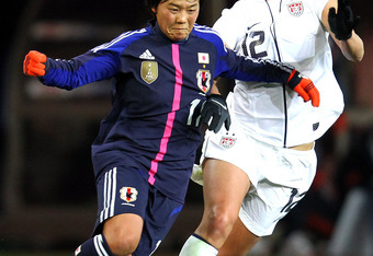 SENDAI, JAPAN - APRIL 01: Shinobu Ohno #11 of Japan and Lauren Cheney #12 of United States compete for the ball during the international friendly match between Japan and United States at Yurtex Stadium Sendai on April 1, 2012 in Sendai, Japan. (Photo by K