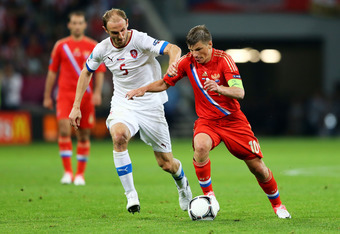 WROCLAW, POLAND - JUNE 08: Andrey Arshavin of Russia and  Roman Hubník of Czech Republic fight for the ball during the UEFA EURO 2012 group A match between Russia and Czech Republic at The Municipal Stadium on June 8, 2012 in Wroclaw, Poland.  (Photo by C