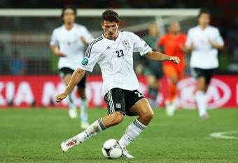 KHARKOV, UKRAINE - JUNE 13: Mario Gomez of Germany in action  during the UEFA EURO 2012 group B match between Netherlands and Germany at Metalist Stadium on June 13, 2012 in Kharkov, Ukraine.  (Photo by Joern Pollex/Getty Images)