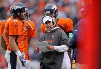DENVER - OCTOBER 04:  Head coach Josh McDaniels of the Denver Broncos, along with quarterback Kyle Orton #8,  leads his team against the Dallas Cowboys during NFL action at Invesco Field at Mile High on October 4, 2009 in Denver, Colorado. The Broncos def