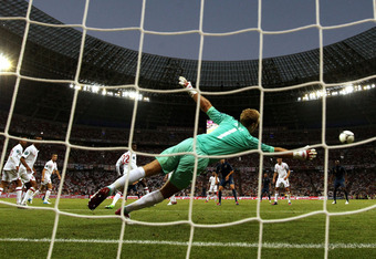 DONETSK, UKRAINE - JUNE 11:  Joe Hart of England dives to make a save during the UEFA EURO 2012 group D match between France and England at Donbass Arena on June 11, 2012 in Donetsk, Ukraine.  (Photo by Ian Walton/Getty Images)