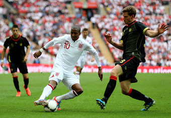 LONDON, ENGLAND - JUNE 02:  Ashley Young of England and Jan Vertonghen of Belgium in action during the international friendly match between England and Belgium at Wembley Stadium on June 2, 2012 in London, England.  (Photo by Clive Mason/Getty Images)
