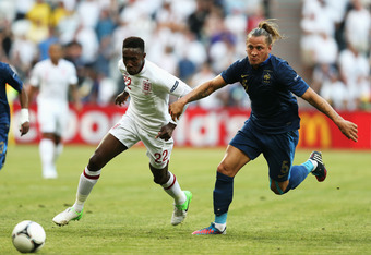 DONETSK, UKRAINE - JUNE 11: Danny Welbeck of England battles with Philippe Mexes of France during the UEFA EURO 2012 group D match between France and England at Donbass Arena on June 11, 2012 in Donetsk, Ukraine.  (Photo by Julian Finney/Getty Images)