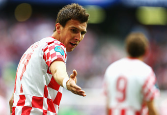 POZNAN, POLAND - JUNE 14:  Mario Mandzukic of Croatia gestures during the UEFA EURO 2012 group C match between Italy and Croatia at The Municipal Stadium on June 14, 2012 in Poznan, Poland.  (Photo by Clive Mason/Getty Images)