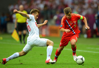 WARSAW, POLAND - JUNE 12:  Andrey Arshavin of Russia is put under pressure by Jakub Blaszczykowski of Poland during the UEFA EURO 2012 group A match between Poland and Russia at The National Stadium on June 12, 2012 in Warsaw, Poland.  (Photo by Shaun Bot