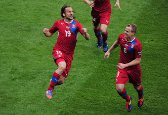 WROCLAW, POLAND - JUNE 12:  Petr Jiracek of Czech Republic celebrates scoring the opening goal with David Limbersky of Czech Republic during the UEFA EURO 2012 group A match between Greece and Czech Republic at The Municipal Stadium on June 12, 2012 in Wr