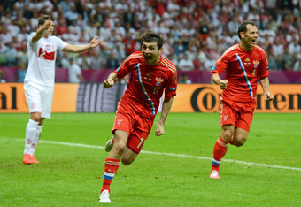 WARSAW, POLAND - JUNE 12:  Alan Dzagoev of Russia celebrates scoring the first goal during the UEFA EURO 2012 group A match between Poland and Russia at The National Stadium on June 12, 2012 in Warsaw, Poland.  (Photo by Shaun Botterill/Getty Images)