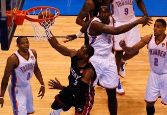 OKLAHOMA CITY, OK - JUNE 14:  Dwyane Wade #3 of the Miami Heat goes up for a layup against Kendrick Perkins #5 of the Oklahoma City Thunder in the first quarter in Game Two of the 2012 NBA Finals at Chesapeake Energy Arena on June 14, 2012 in Oklahoma Cit
