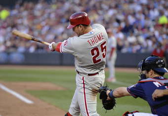 MINNEAPOLIS, MN - JUNE 13: Jim Thome #25 of the Philadelphia Phillies hits a two-run home run as Joe Mauer #7 of the Minnesota Twins catches during the fourth inning on June 13, 2012 at Target Field in Minneapolis, Minnesota. The Phillies defeated the Twi