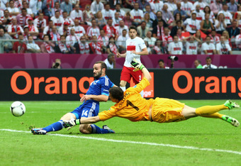 WARSAW, POLAND - JUNE 08: Wojciech Szczesny of Poland fails to stop Dimitris Salpigidis of Greece score the equalising goal during the UEFA EURO 2012 group A match between Poland and Greece at The National Stadium on June 8, 2012 in Warsaw, Poland.  (Phot