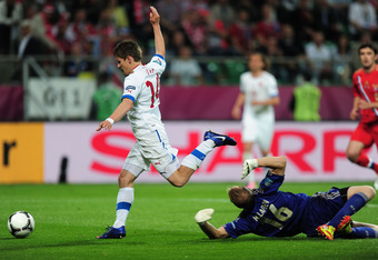 WROCLAW, POLAND - JUNE 08:  Vaclav Pilar of Czech Republic goes past goalkeeper Vyacheslav Malafeev of Russia to score their first goal during the UEFA EURO 2012 group A match between Russia and Czech Republic at The Municipal Stadium on June 8, 2012 in W
