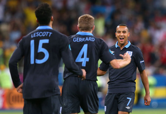 KIEV, UKRAINE - JUNE 15:  Theo Walcott of England celebrates scoring their second goal during the UEFA EURO 2012 group D match between Sweden and England at The Olympic Stadium on June 15, 2012 in Kiev, Ukraine.  (Photo by Alex Livesey/Getty Images)